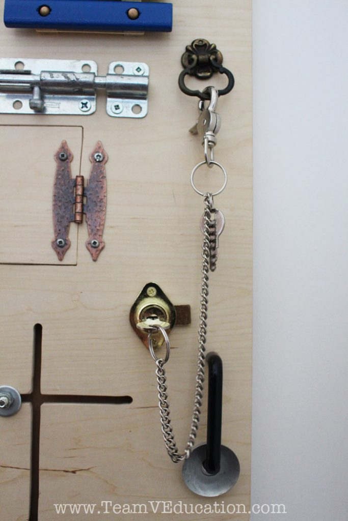 DIY Toddler Busy Board with peek-a-boo doors, latches, locks, and more!