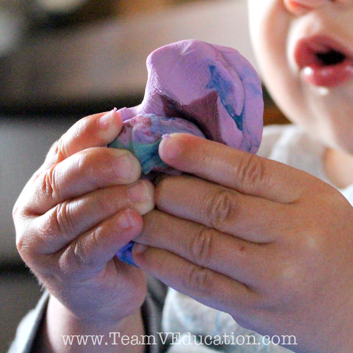 What does it look like to explore play dough for THE FIRST TIME?! Beautiful photos documenting a toddler's first experience.